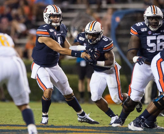 Auburn quarterback Joey Gatewood (1) hands the ball off to running back Shaun Shivers (8) at Jordan-Hare Stadium in Auburn, Ala., on Saturday, Sept. 14, 2019. Auburn defeated Kent State 55-16.