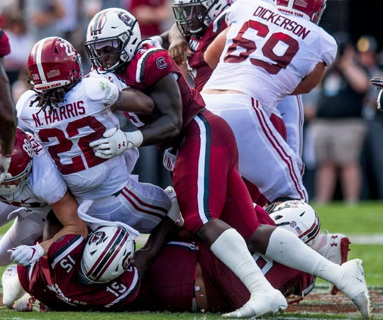 Alabama running back Najee Harris (22) is stopped by South Carolina defensive linemen Javon Kinlaw (3) and Aaron Sterling (15) at Williams-Brice Stadium in Columbia, S.C., on Saturday September 14, 2019.