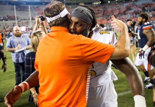 Auburn head coach Gus Malzahn hugs Kent State quarterback and former Auburn player Woody Barrett (15) after the game at Jordan-Hare Stadium in Auburn, Ala., on Saturday, Sept. 14, 2019. Auburn defeated Kent State 55-16.