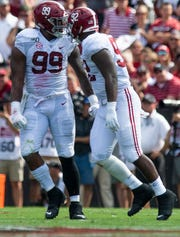 Alabama defensive linemen Raekwon Davis (99) and Justin Eboigbe (92) celebrate against South Carolina at Williams-Brice Stadium in Columbia, S.C., on Saturday September 14, 2019.