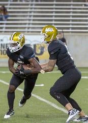 ASU quarterback Jett Even (6) hands off the ball to ASU running back Jacory Merritt (21).