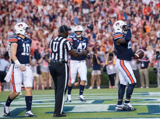 Auburn running back JaTarvious Whitlow (28) celebrates after running in for a touchdown at Jordan-Hare Stadium in Auburn, Ala., on Saturday, Sept. 14, 2019. Auburn leads Kent State 24-10 at halftime.