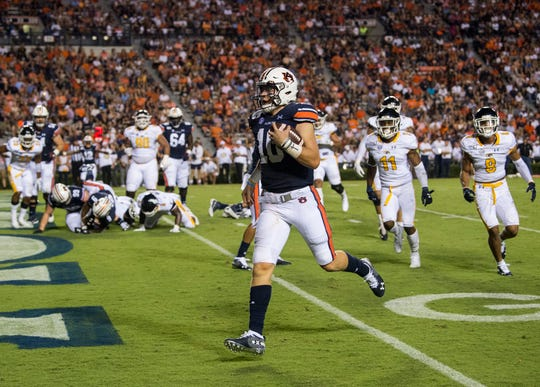 Auburn quarterback Bo Nix (10) runs into the end zone for a touchdown at Jordan-Hare Stadium in Auburn, Ala., on Saturday, Sept. 14, 2019. Auburn leads Kent State 24-10 at halftime.