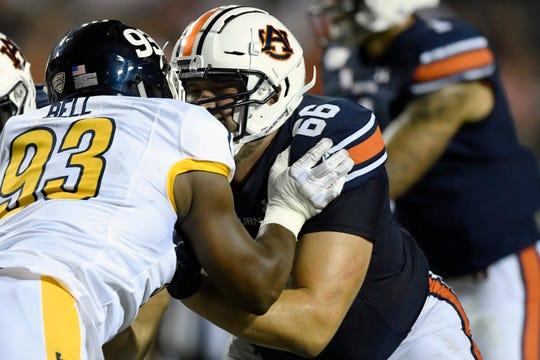Auburn left tackle Bailey Sharp blocks Kent State defensive lineman Matt Bell on Saturday, Sept. 14, 2019 in Auburn, Ala.