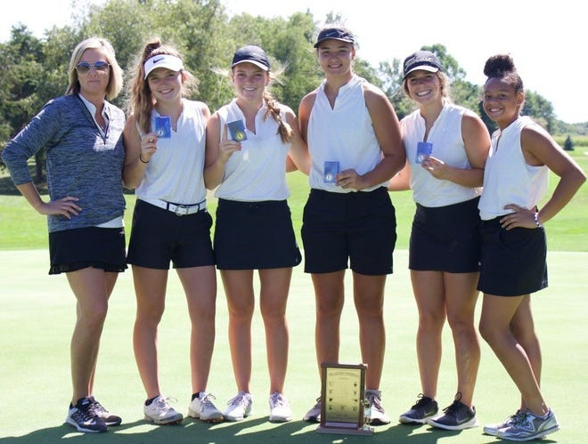 The Winchester girls golf team poses for a picture after winning the TEC Tournament.