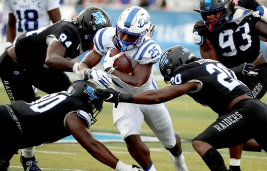 Duke running back Deon Jackson (25) runs the ball as he is surrounded by MTSU defensive end Tyshun Render (94), MTSU defensive tackle Rakavian Poydras (90), MTSU linebacker DQ Thomas (20) and MTSU defensive tackle Malik Manciel (93) on Saturday Sept. 14, 2019, at MTSU.