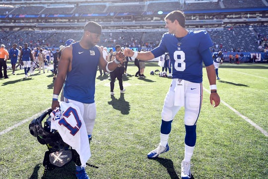 New York Giants running back Saquon Barkley, left, and quarterback Daniel Jones fist bump after a loss against the Buffalo Bills on Sunday, Sept. 15, 2019, in East Rutherford.