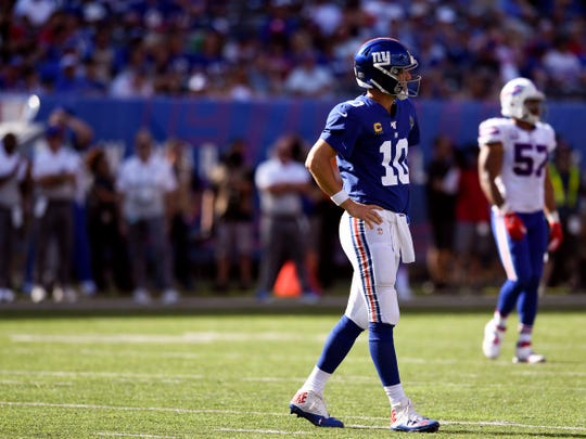 New York Giants quarterback Eli Manning walks off the field after failing to convert on downs. The New York Giants lost their home opener against the Buffalo Bills, 28-14, on Sunday, Sept. 15, 2019, in East Rutherford.