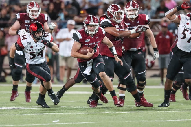 NMSU redshirt sophomore quarterback Josh Adkins (14) runs the ball in the second half during a game against San Diego State at Aggie Memorial Stadium in Las Cruces on Saturday, Sept. 14, 2019.