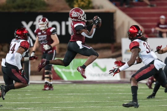 NMSU graduate student wide receiver Tony Nicholson (13) catches the ball in the second half during a game against San Diego State at Aggie Memorial Stadium in Las Cruces on Saturday, Sept. 14, 2019.