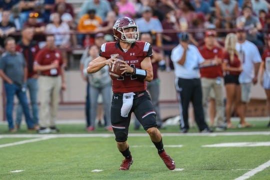New Mexico State quarterback Josh Adkins looks for an open receiver during Saturday's game against San Diego State at Aggie Memorial Stadium.