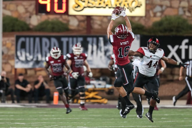 NMSU redshirt Junior wide receiver Jared Wyatt (16) receives in the second half during a game against San Diego State at Aggie Memorial Stadium in Las Cruces on Saturday, Sept. 14, 2019.