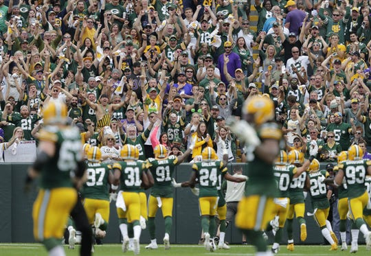 Fans celebrate an interception by Green Bay Packers linebacker Preston Smith (91) in the second quarter of the team's Sept. 15 game against the Minnesota Vikings.