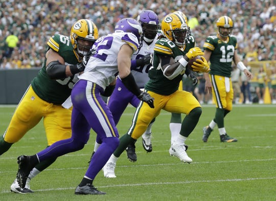 Green Bay Packers running back Jamaal Williams (30) breaks away for a touchdown run against the Minnesota Vikings in the first quarter during their football game Sunday, September 15, 2019, at Lambeau Field in Green Bay, Wis.