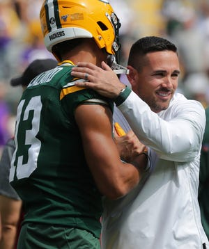 Green Bay Packers head coach Matt LaFleur embraces wide receiver Allen Lazard (13) before their game against the Minnesota Vikings Sunday. September 15, 2019 at Lambeau Field in Green Bay, Wis.