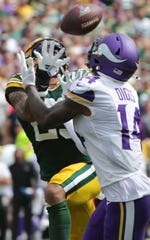 Minnesota Vikings wide receiver Stefon Diggs (14) beats Green Bay Packers cornerback Jaire Alexander (23) to reel in a 45 card touchdown reception during the third quarter of their game Sunday. September 15, 2019 at Lambeau Field in Green Bay, Wis. The Green Bay Packers beat the Minnesota Vikings 21-16.