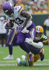 Minnesota Vikings running back Dalvin Cook (33) is tackled short a first down buy Green Bay Packers outside linebacker Preston Smith (91) during the the quarter of their game Sunday. September 15, 2019 at Lambeau Field in Green Bay, Wis. The Green Bay Packers beat the Minnesota Vikings 21-16.