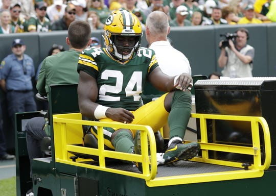 Green Bay Packers defensive back Raven Greene (24) is carted off of the field in the third quarter during their football game Sunday, September 15, 2019, at Lambeau Field in Green Bay, Wis.