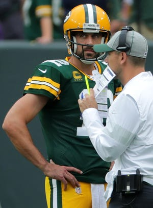 Green Bay Packers quarterback Aaron Rodgers (12) and Matt LaFleur talk during the third quarter of their game Sept. 15, 2019, at Lambeau Field in Green Bay. The Green Bay Packers beat the Minnesota Vikings 21-16.