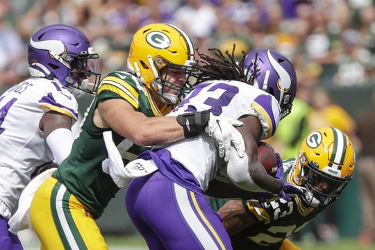 Green Bay Packers inside linebacker Blake Martinez (50) tackles Minnesota Vikings running back Dalvin Cook (33) during their football game Sunday, September 15, 2019, at Lambeau Field in Green Bay, Wis.