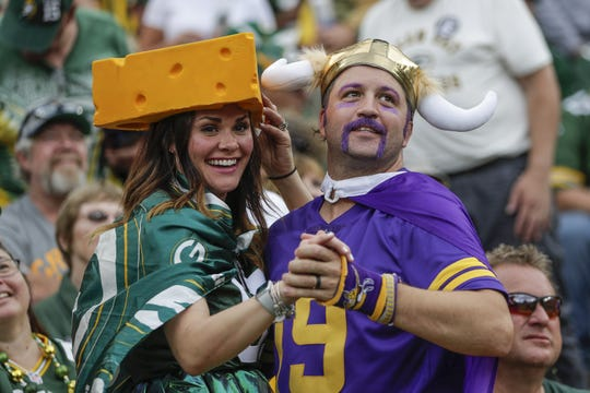"Tessa and Joey Neigum, of Madison, dance to ""Roll Out the Barrel"" at the start of the fourth quarter during the Green Bay Packers-Minnesota Vikings game on Sept. 15, 2019."