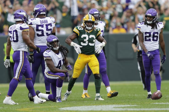 Green Bay Packers running back Aaron Jones (33) celebrates after taking a big hit on a first down run against the Minnesota Vikings in the third quarter during their football game Sunday, September 15, 2019, at Lambeau Field in Green Bay, Wis.
