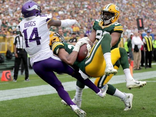 Green Bay Packers cornerback Kevin King (20) intercepts a pass in the end zone that was intended for Minnesota Vikings wide receiver Stefon Diggs (14) during the fourth quarter their football game Sunday, August 15, 2019, at Lambeau Field in Green Bay, Wis.