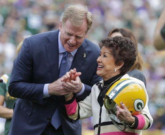 NFL Commissioner Roger Goodell presents a Green Bay Packers helmet to Cherry Starr at a halftime ceremony honoring her late husband Bart Starr Sunday, September 15, 2019, at Lambeau Field in Green Bay, Wis.