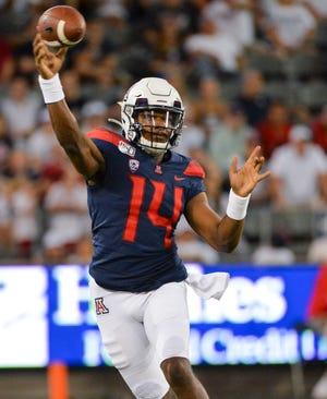 Sep 14, 2019; Tucson, AZ, USA; Arizona Wildcats quarterback Khalil Tate (14) passes the ball during the first half against the Texas Tech Red Raiders at Arizona Stadium. Mandatory Credit: Casey Sapio-USA TODAY Sports