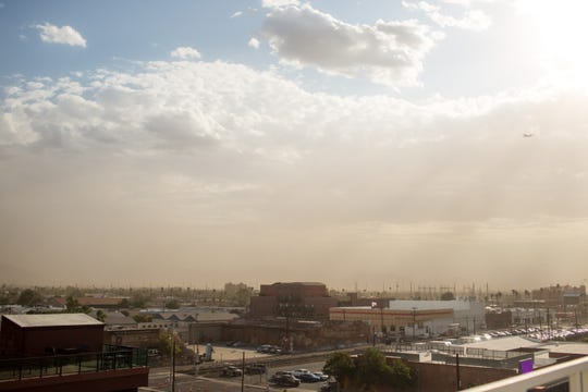 Wind blows dust over the warehouse district of Phoenix on Saturday, Sept. 14, 2019.