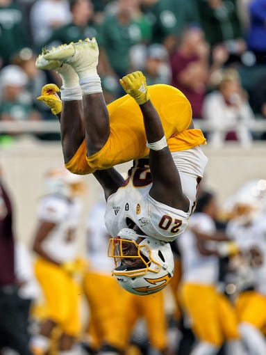 Sep 14, 2019; East Lansing, MI, USA; Arizona State Sun Devils linebacker Khaylan Kearse-Thomas (20) does a flip to celebrate a win over Michigan State Spartans during the second half of a game at Spartan Stadium.