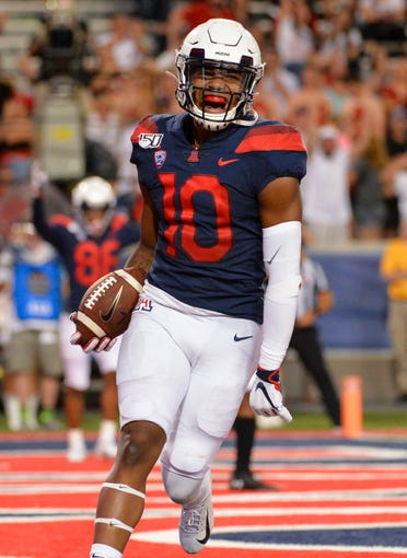 Sep 14, 2019; Tucson, AZ, USA; Arizona Wildcats wide receiver Jamarye Joiner (10) celebrates after scoring a touchdown against the Texas Tech Red Raiders during the second half at Arizona Stadium. Mandatory Credit: Casey Sapio-USA TODAY Sports