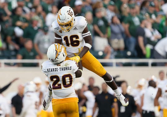 Sep 14, 2019: Arizona State Sun Devils linebacker Khaylan Kearse-Thomas (20) and Arizona State Sun Devils safety Aashari Crosswell (16) celebrate a win over Michigan State Spartans during the second half of a game at Spartan Stadium.