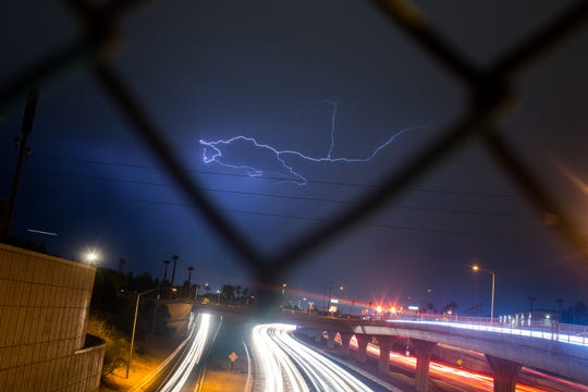 Lightning strikes over I-10 Saturday, September 14, 2019 in downtown Phoenix.