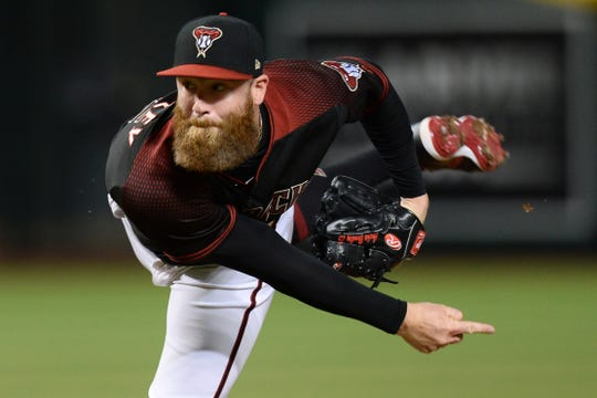 Sep 14, 2019; Phoenix, AZ, USA; Arizona Diamondbacks relief pitcher Archie Bradley (25) pitches against the Cincinnati Reds during the ninth inning at Chase Field. Mandatory Credit: Joe Camporeale-USA TODAY Sports