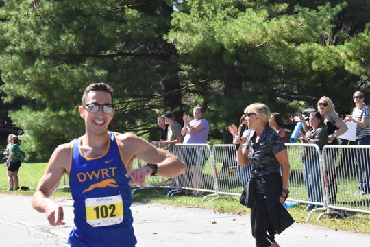 Hyde Park native Garrett Burger crosses the finish line to win the men's marathon at the Dutchess County Classic on Sunday.