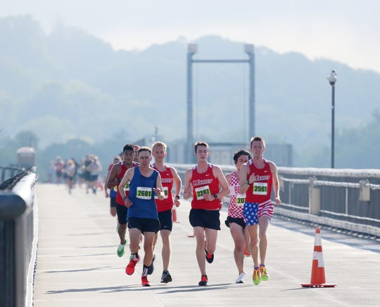The leaders of the marathon make their way over the Walkway Over The Hudson during the 41st Dutchess County Classic in the City of Poughkeepsie on September 15, 2019.