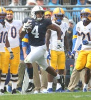 Penn State's Journey Brown runs away from the Pitt defense on Saturday.