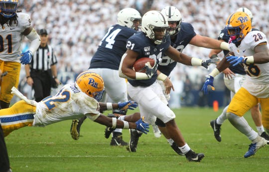 Penn State's Noah Cain finds room to run against Pitt on Saturday.
