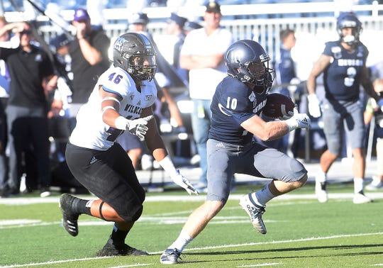 Nevada's Ben Putman looks for running room after catching a pass on Saturday against Weber State.
