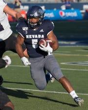 Nevada running back Jaxson Kincaide breaks outside for a touchdown against Weber State.