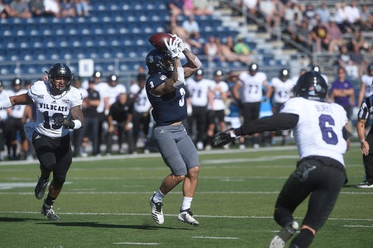 Nevada's Kaleb Fossum (3) makes a catch while taking on Weber St. during their football game at Mackay Stadium in Reno on Sept. 14, 2019.