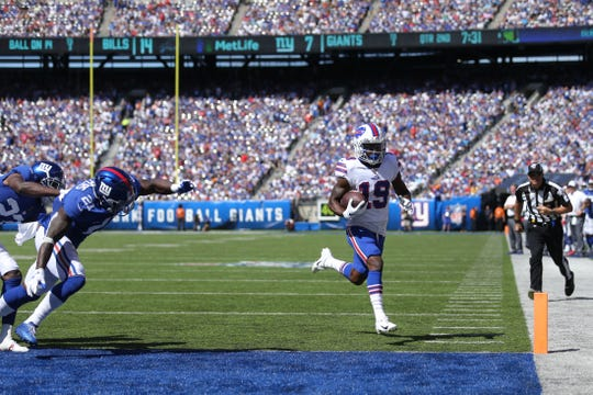 Buffalo Bills wide receiver Isaiah McKenzie (19) heads for the end zone during the second quarter against the New York Giants on Sunday. McKenzie scored on a 14-yard reception.