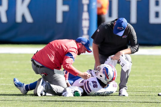 Buffalo Bills running back Devin Singletary (26) is treated by medical staff during the second half against the New York Giants at MetLife Stadium.