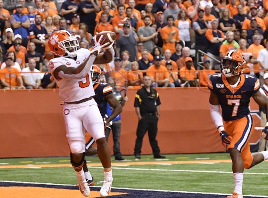 Clemson Tigers wide receiver Amari Rodgers (3) catches a touchdown in front of Syracuse Orange defensive back Andre Cisco (7) during the first quarter at the Carrier Dome.
