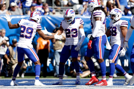 Buffalo Bills' Micah Hyde (23) celebrates with teammates during the first half of an NFL football game against the New York Giants, Sunday, Sept. 15, 2019, in East Rutherford, N.J. (AP Photo/Adam Hunger)