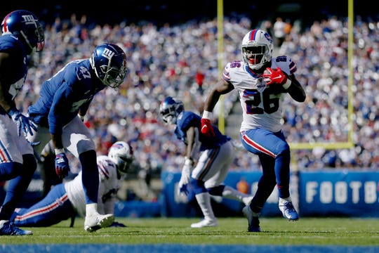 Buffalo Bills running back Devin Singletary (26) runs the ball against the New York Giants during the fourth quarter at MetLife Stadium.