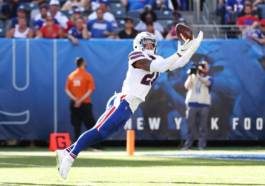 EAST RUTHERFORD, NEW JERSEY - SEPTEMBER 15:  Jordan Poyer #21 of the Buffalo Bills intercepts a pass by Eli Manning #10 of the New York Giants during their game at MetLife Stadium on September 15, 2019 in East Rutherford, New Jersey. (Photo by Al Bello/Getty Images)