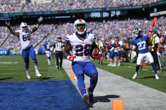 Sep 15, 2019; East Rutherford, NJ, USA; Buffalo Bills running back Devin Singletary (26) runs for a touchdown against the New York Giants during the second quarter at MetLife Stadium. Mandatory Credit: Brad Penner-USA TODAY Sports
