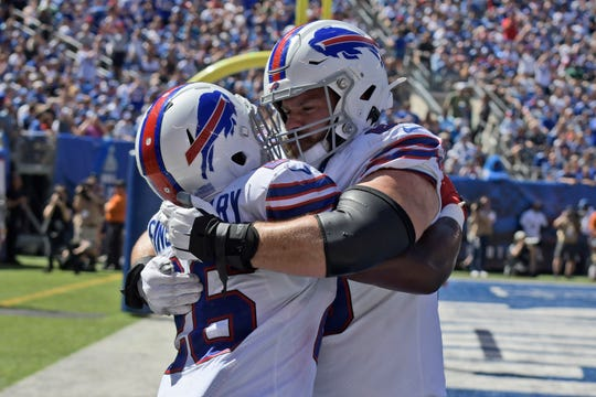 Buffalo Bills running back Devin Singletary, left celebrates his touchdown with Mitch Morse during the first half of Sunday's win over the New York Giants.